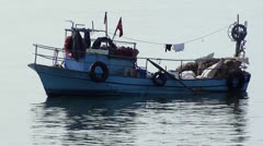 Small fishing boat zoom out Stock Footage