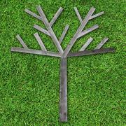 wooden tree made of wood on green grass for fill object or photo - stock photo