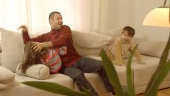 Father and children having fun while wrestling each other. Stock Footage