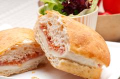 ciabatta panini sandwich with parma ham and tomato - stock photo