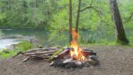 Stock Video Footage of River Campsite Fire