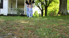 Baby girl first steps outside Stock Footage
