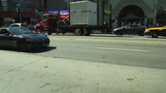 Stock Video Footage of Luxury Sports Car Maserati on Hollywood Boulvard - Chinese Theatre