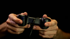 Playing game on Joystick/gamepad front shot close up Stock Footage