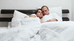 Sweet conversation in morning bed Stock Footage