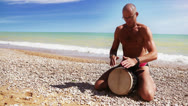 Stock Video Footage of Djembe Drum Player beat rythm on the lonely beach
