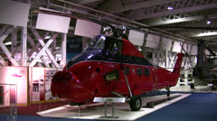 Red helicopter inside an aviation museum - stock footage