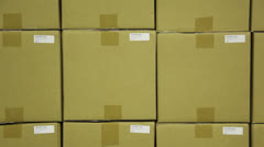 warehouse, placing a fragile sticker. - stock footage