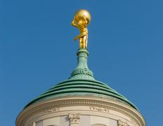 Atlas in gold carrying the world potsdam Stock Photos