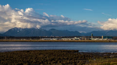 Time Lape of YVR traffic with cloudy sky background as it getting low tide Stock Footage