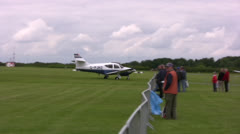 Small passenger plane taxiing short distance on an airfield Stock Footage