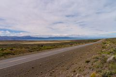 lake viedma with endless road in argentina patagonia - stock photo