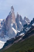 cerro torre from trekking road heading to the base camp - stock photo