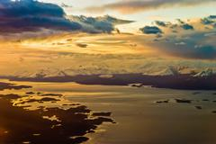 in the airplane close to ushuaia sunset mood - stock photo