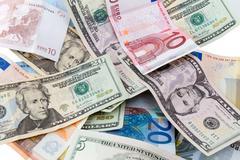 Euro and Dollar banknotes - stock photo