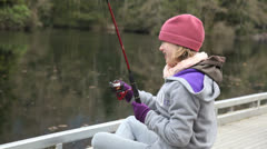Girl trout fishing. Stock Footage
