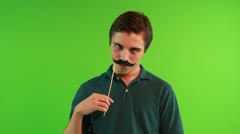 Young Boy wears the Mustache Mask Stock Footage