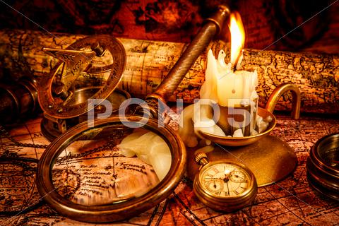 Stock photo of vintage still life. vintage items on ancient map.