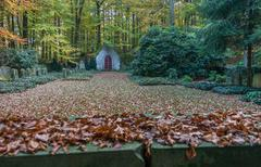 Forest cemetary with chapel and wall Stock Photos