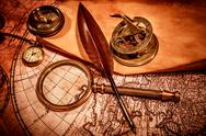Vintage magnifying glass lies on an ancient world map Stock Photos