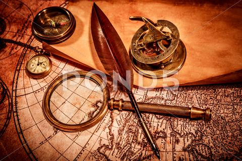 Stock photo of vintage magnifying glass lies on an ancient world map