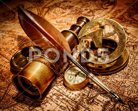 Stock photo of vintage items on ancient map.