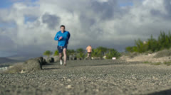 Young couple jogging on the beach, slow motion shot at 240fps Stock Footage