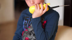 Boy talking on walkie talkie Stock Footage