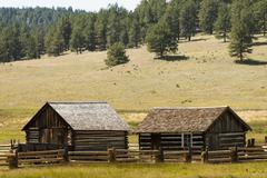 rustic log cabin on the farm - stock photo