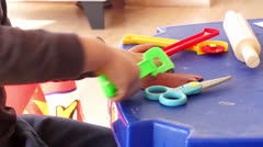 Child playing with plasteline Stock Footage