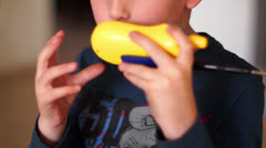 Boy talking on walkie talkie - stock footage