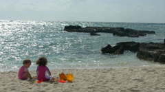 Young kids playing on the Beach Stock Footage