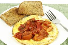Organic eggs toast tomato Stock Photos