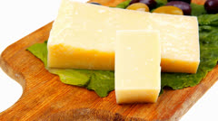 Swiss cheese on wooden platter Stock Footage