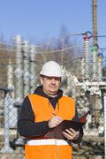 Electrical engineer written documentation near to the electric substations Stock Photos