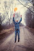 the cheerful boy with a balloon - stock photo