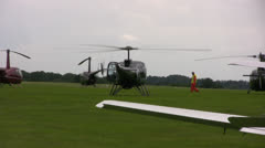 Civilian Helicopter just landed with rotor blades spinning - stock footage