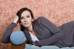 Bautiful teenager on the couch Stock Photos