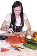 cute teenager preparing food - stock photo