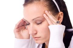 teenager with a headache - stock photo