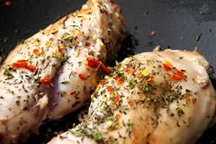 White meat in a frying pan Stock Photos