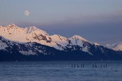 Moonrise over Alaskan Mountain Range - stock photo