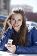 Stock Photo of young woman reading a message on the phone