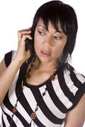 asian - hispanic businesswoman talking on the cell phone - stock photo