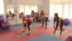 Sexy girls working out in modern gym club . Stock Footage