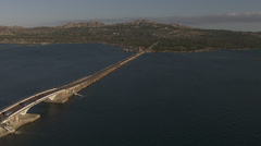 Aerial shot of long bridge in the mediterranean sea, Sardinia / Italy Stock Footage