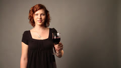 Young Caucasian lady shows the wine glass Stock Footage
