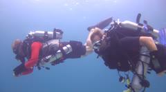 Rebreather Divers decending Stock Footage
