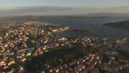 Stock Video Footage of slow flight over coastal city, Sardinia / Italy