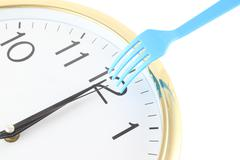 alert on lunch time at twelve noon. - stock photo